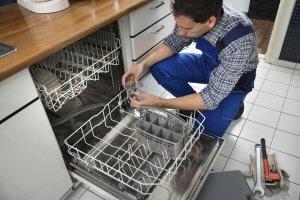 Dishwasher Repair Person Repairing Dishwasher